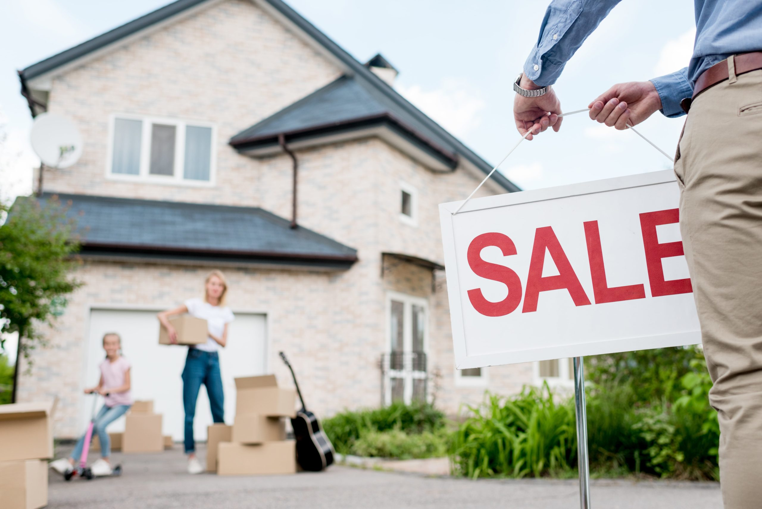 Cropped image male realtor sale